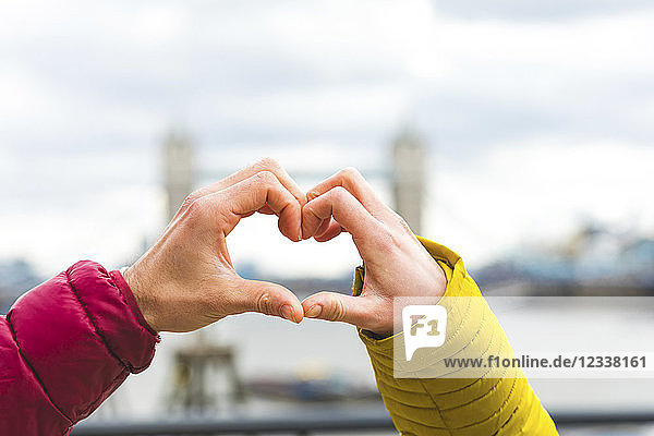UK  London  hands of young couple in love forming heart  close-up