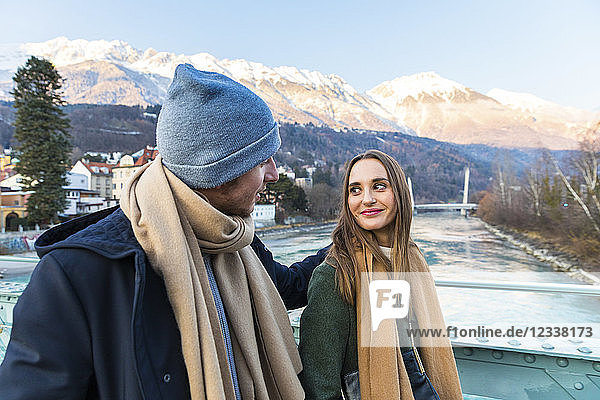 Austria  Innsbruck  young couple strolling together in winter
