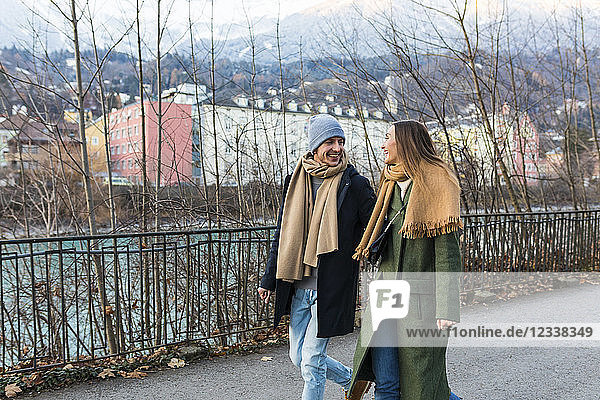 Austria  Innsbruck  happy young couple strolling together at winter time