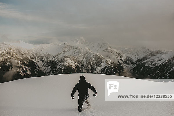 Man in deep snow on mountain  Abbotsford  Canada