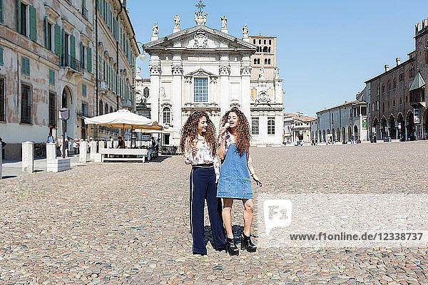 Fashion blogger twins eating ice cream  Mantova  Lombardia  Italy