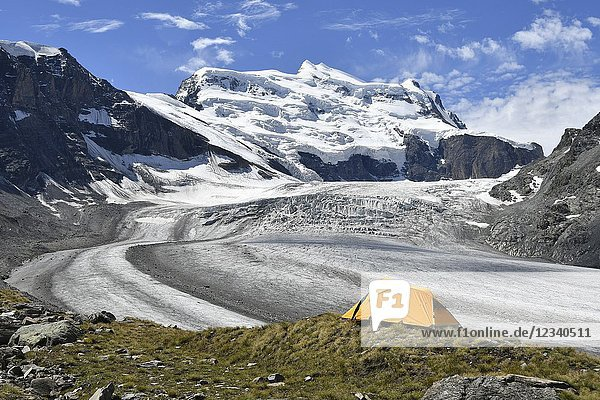Camping on the ridge of moraine  close to the Grand Combin glacier  Grand Combin on background Switzerland Swiss.