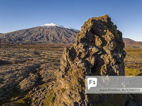Londrangar Sea Stacks-basalt volcanic dikes  in the distance  Snaefellsjokull Glacier  Snaefellsnes Peninsula  Western Iceland.