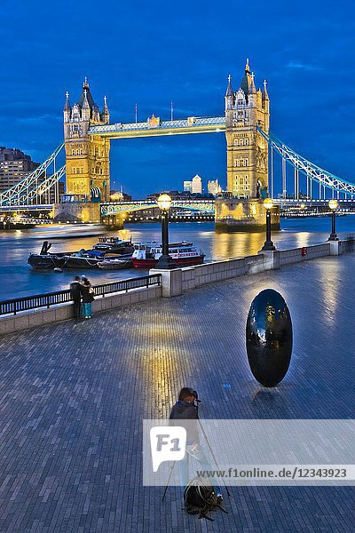 Photographing with tripod  Egg shaped sculpture  on background Tower Bridge  Riverside Southwark  River Thames  London  England  UK  United Kingdom  Europe
