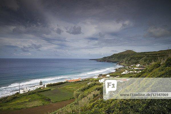 Portugal  Azores  Santa Maria Island  Praia  elevated view of town and Praia Formosa beach  morning.