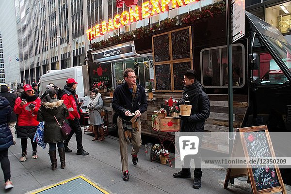 Applegate Farms gives away bacon in various forms at a branding event in Midtown Manhattan in New York on Friday  December 15  2017. Hormel Foods is the owner of the Applegate Farms brand  a maker of organic processed meat. Consumers are turning away from large food makers and are embracing companies that they perceive as smaller and healthier.