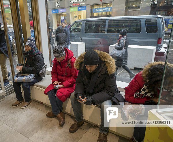 Shoppers on their cell phones in Nintendo World in Rockefeller Center in New York on Saturday  December 30  2017. The Nintendo Switch is a big hit for the company selling 10 million units in the first 9 month since its launch.