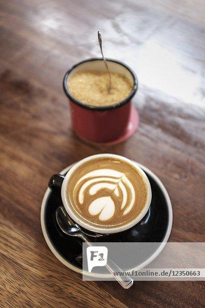 Flat White coffee and ssugar pot.