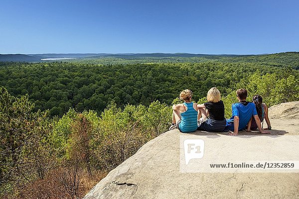 Hikers sitting enjoying the view  Algonquin Provincial Park  Ontario  Canada.