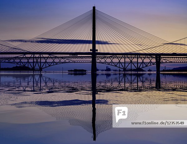 Sunrise view of the three major bridges crossing the Firth of Forth at South Queensferry  Queensferry Crossing  North Road Bridge and the Forth Bridge ( rail)   Scotland  United Kingdom.
