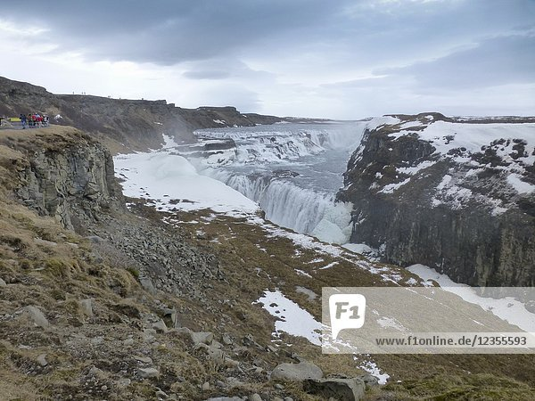 Amazing Icelandic winter landscape of majestic waterfall of frozen Gullfoss.