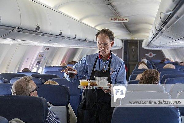 Detroit  Michigan - A flight attendant serves drinks on a Southwest Airlines flight from Detroit to Atlanta.