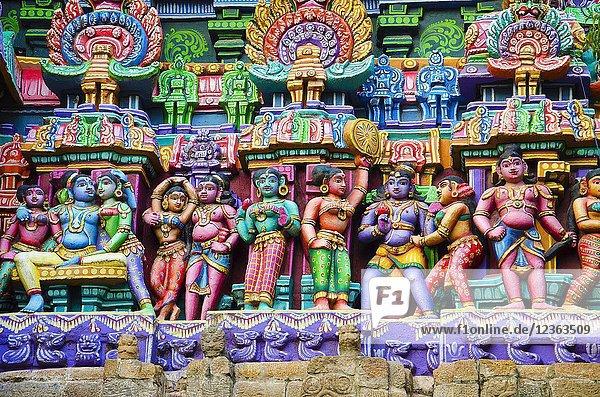 Colorful idols on the Gopuram  Sarangapani Temple  Kumbakonam  Tamil Nadu  India. It is one among the three major shrines of Lord Vishnu. Renovated during the period of Nayaka Kingdom of 16th century. Sarangapani temple consists of only one holy tank known as Porthamarai Kulam. The Karuvarai and Vimanam are made with 12-sculptured columns shaped like a chariot. The main deity of Sarangapani Temple is Sarangapani swamy with Komalavalli Thayar.