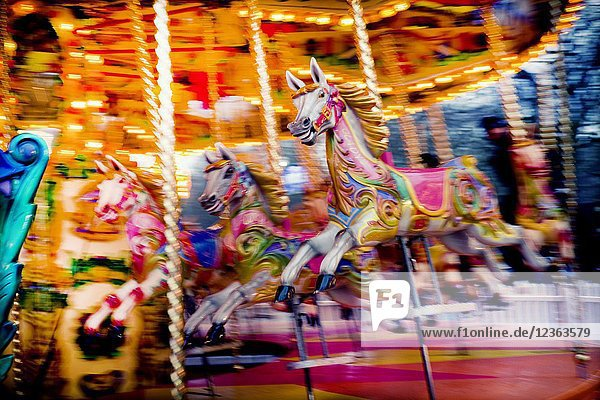Horses on a fairground carousel at Winter Wonderland in Hyde Park. Hyde Park  London  England.