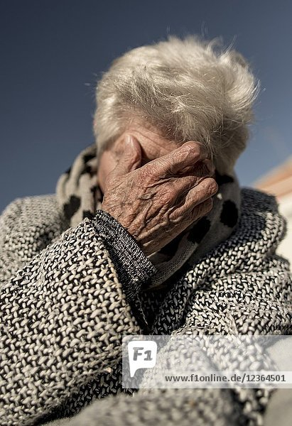 Elderly person covering his face Valencia  Spain