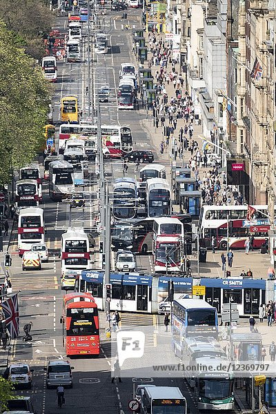 Busy traffic on Princes Street shopping street in central Edinburgh  Scotland  UK.