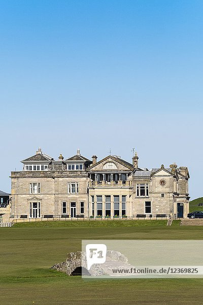 Exterior view of the club house of The Royal and Ancient Golf Club (R&A) and famous old Swilken Bridge over Swilken Burn on 18th Hole atOld Course in St Andrews  Fife  Scotland  UK.
