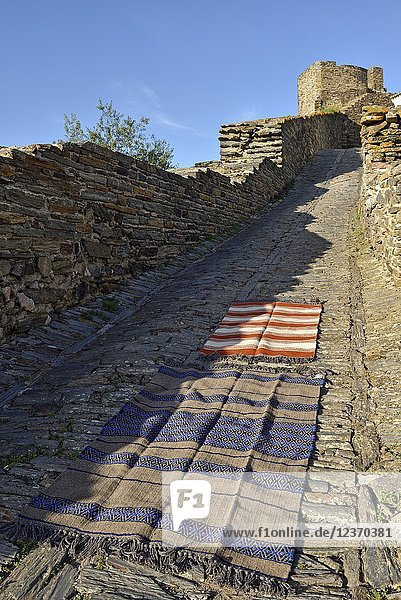 Some types of blankets and carpets from the Fabrica Alentejana de Lanificios  displayed on a cobbled street in the perched village Monsaraz  Municipality of Reguengos de Monsaraz  Alentejo region  Portugal  southwertern Europe.