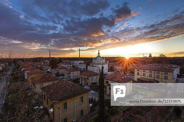 Winter sunset over the model worker village of Crespi d'Adda  Unesco World Heritage Site. Capriate San Gervasio  Bergamo province  Lombardy  Italy.
