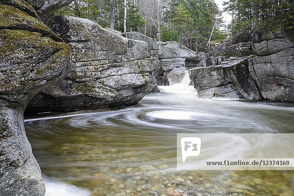 Upper Ammonoosuc Falls  which are located along the Ammonoosuc River in Crawford's Purchase of the New Hampshire White Mountains during the spring months.