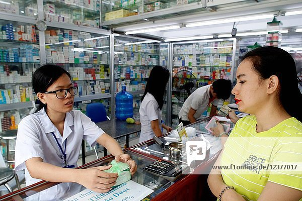 Woman in pharmacy.