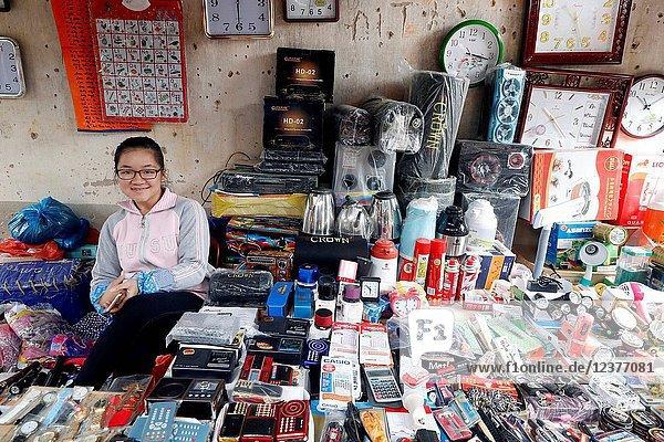 Stalls selling electronics in Van Quan market.