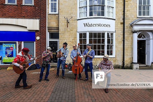 A Group Of Musicians Playing Music In The High Street  Lewes  Sussex  England.