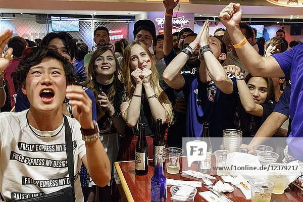 Soccer fans react as they watch the FIFA World Cup Group H match between Poland and Japan at Hooters restaurant in Shibuya on June 29  2018  Tokyo  Japan. Japan sealed their position to the second round of the FIFA World Cup despite losing to Poland 1-0 in Volgograd Arena in Volgograd  Russia.
