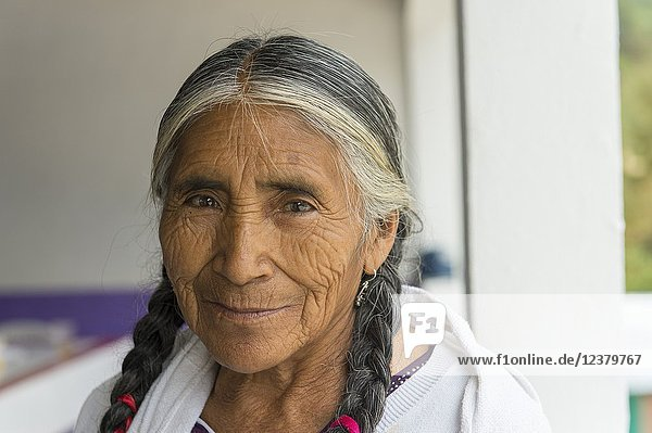 Portrait of a senior Mixtec woman with braided hair in the Mixtec village of San Juan Contreras near Oaxaca  Mexico.