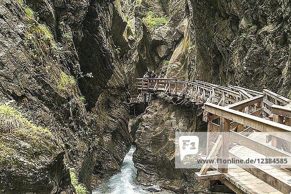 Wooden footbridge on a rock face over the mountain river Kapruner Ache in gorge  Sigmund-Thun-Klamm  Kaprun  Salzburg  Austria  Europe