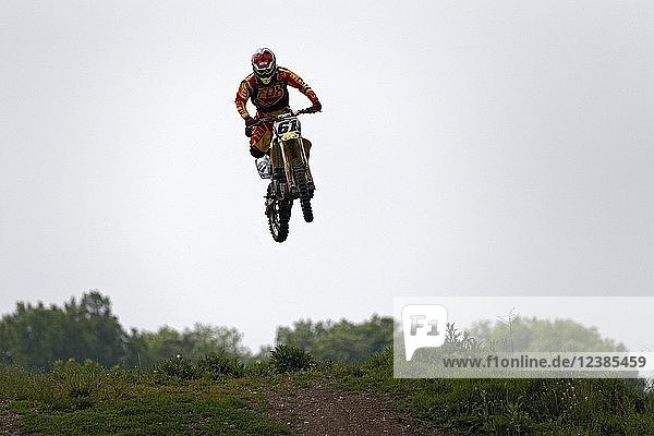 Motocross rider performing a stunt  Munich  Upper Bavaria  Germany  Europe