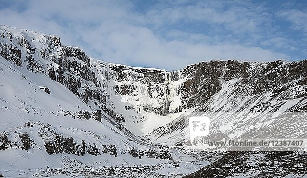 Hengifoss Waterfall  snowy landscape with river Hengifossá  near Vallanes  Austurland  East Iceland  Iceland  Europe