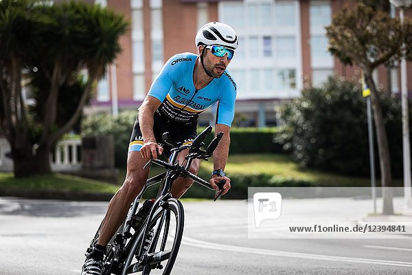 CASTRO URDIALES  SPAIN - APRIL 22  2018: Unidentified athlete in the cycling competition during the III Duathlon Triflavi of Castro Urdiales