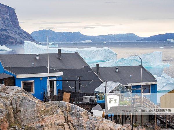 Small town Uummannaq in the north of west greenland. Background the glaciated Nuussuaq (Nugssuaq) Peninsula. America  North America  Greenland  Denmark.