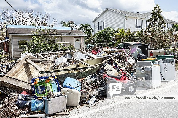 Florida  Everglades City  after Hurricane Irma  houses homes residences  storm disaster recovery cleanup  flood surge damage destruction aftermath  trash  debris pile  Fisherman's Cove  mobile home trailer park  personal belongings  appliances