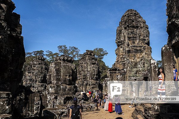 Detail of the stone faces on the bridge at the south gate of Angkor Thom  Angkor Temples complex  Cambodia  Asia