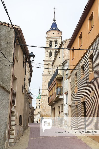 Street of the church with the bell tower and the town hall of Fuendejalon  Aragon  Spain
