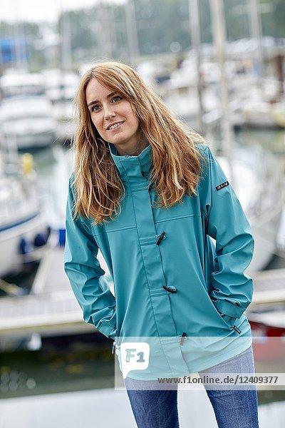 Woman with raincoat  Port De Plaisance  Mouth of the Adour River  Anglet  Biarritz  Atlantic Pyrenees  France  Europe