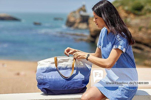 Woman in sailor clothes  Beach  Plage du Port Vieux  Biarritz  Pyrenees Atlantiques  France  Europe