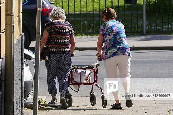 Two older women walk together with a walker. Stockholm  Sweden