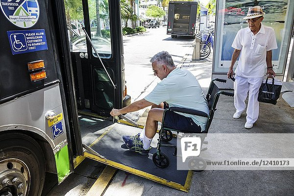 Florida  Miami Beach  bus  Miami-Dade Metrobus  public transportation  disabled  ramp  man  passenger  wheelchair  boarding  ADA compliance