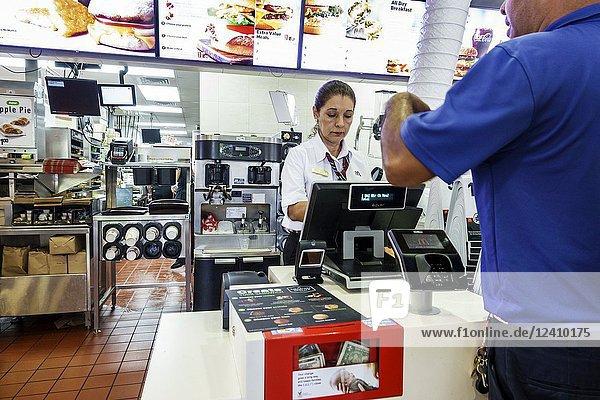 Florida  Miami Beach  McDonald's  restaurant  interior  fast food  counter  woman  man  customer  cashier  Ronald McDonald House donation box  employee job worker
