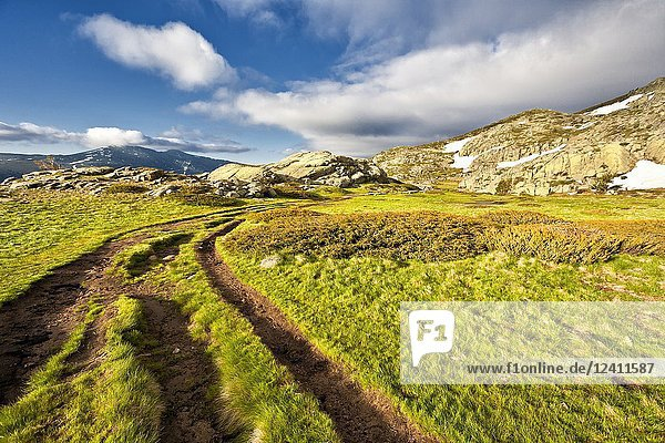 Path to the Lagoons in Penialara and Iron Heads peaks on the background. Madrid. Spain.