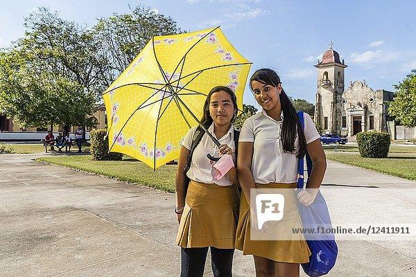 Young school girls in the town square in Nueva Gerona on Isla de la Juventud  Cuba.