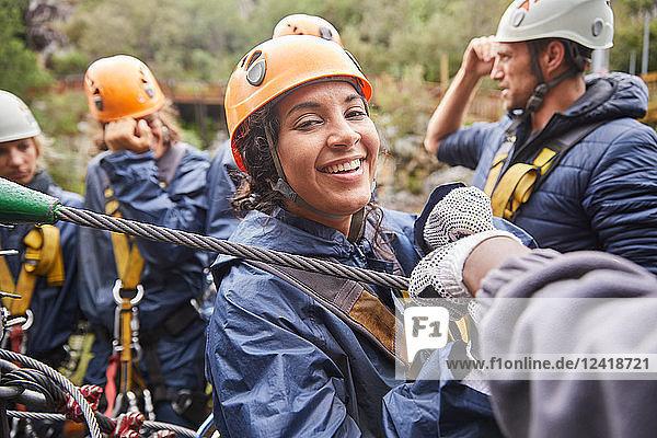 Portrait smiling woman zip lining