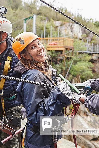 Portrait smiling  confident woman preparing to zip line