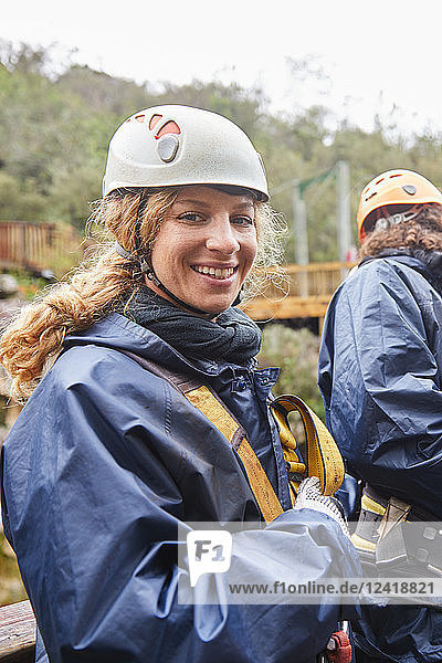 Portrait smiling  confident woman preparing to zip line