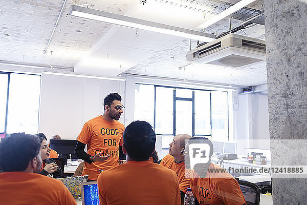 Hacker leading discussion  coding for charity at hackathon