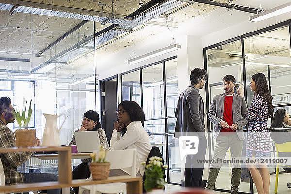 Business people talking and working in office