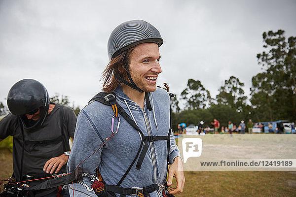 Smiling male paraglider